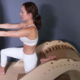 Student of pilates program Mindful Movements doing a stretch